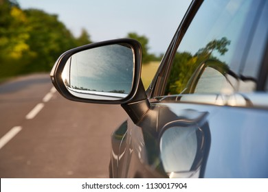 Car on the road, side detail