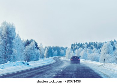 Car on the road at winter Rovaniemi, in Lapland, Finland