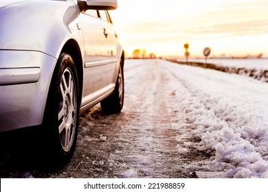 Car on a snowy street.