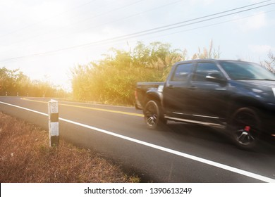 Car on street in the countryside with the traveling at sunlight.