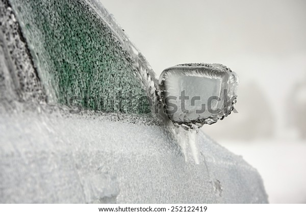 Car on the street covered by icy rain.