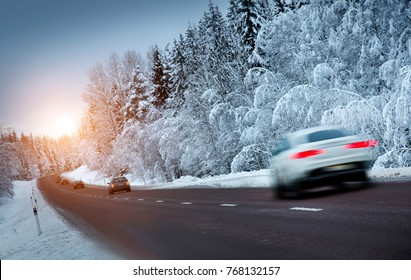 Car on winter forest road