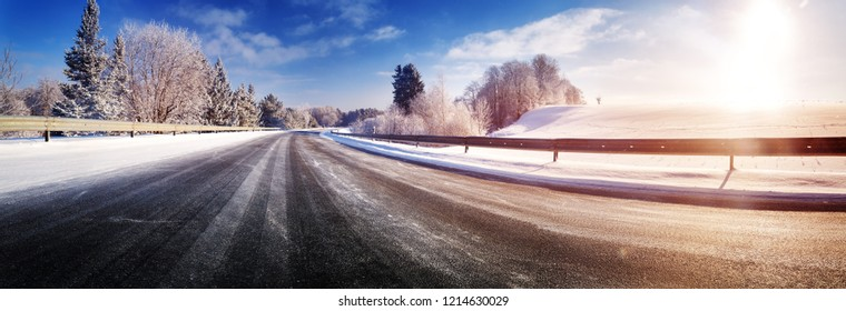 Car on winter road covered with snow