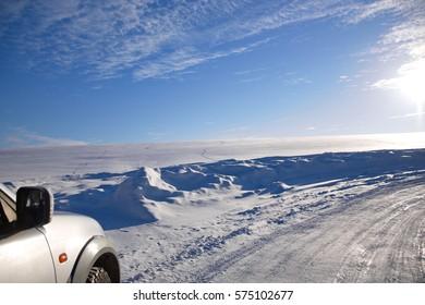 car on winter road landscape