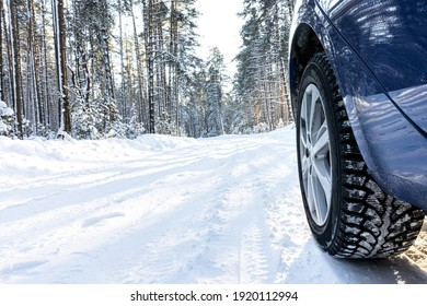 car on a winter road in a snowy forest, winter journey