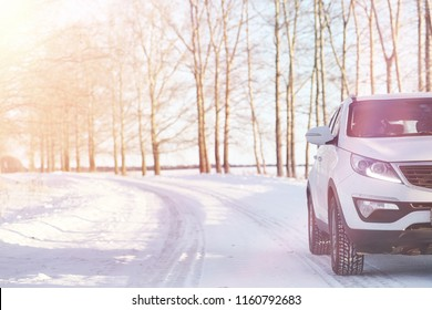 Car on a winter snow road