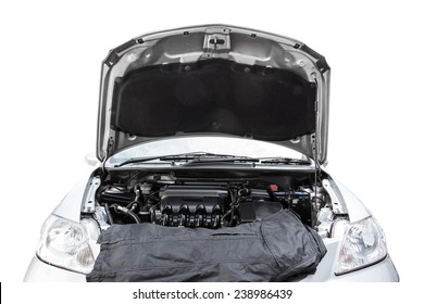 Car with open hood in auto repair shop isolated on white background with clipping path