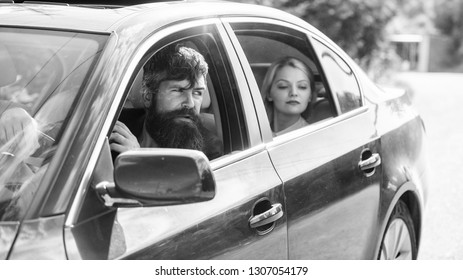Car with open windows and passenger. Business lady passenger has private driver. Personal assistant and driver. Business life concept. Business woman sit on backseat while bearded driver sit in front.