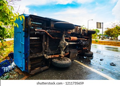 Car overturned on the road after rain