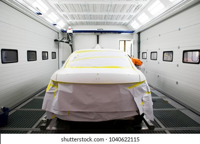 car in paint room at the garage