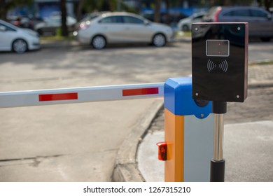 car park automatic entry system.Security system for building access - barrier gate stop with toll booth, traffic cones.