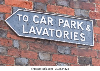 To Car Park and Lavatories sign on wall