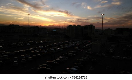 "Car park with many vehicles in evening and reflecting of sun on car roof ""Muscat, Oman - December,8 2017"""