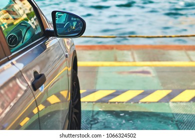 Car parked on the ferry over the lake Como in Italy on a sunny summer day