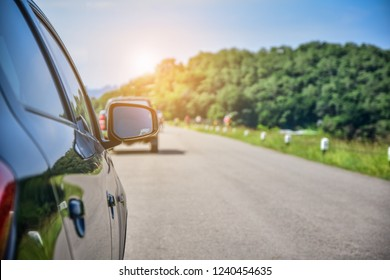 Car parked on road,Car driving on road