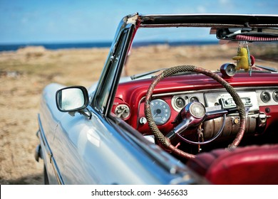 the car is parked on seacoast of havana