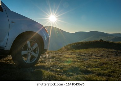 Car parked on the top of a mountain, holiday concept