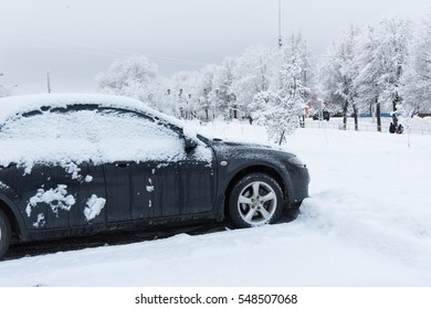 car is parked tunes with a thick layer of snow blizzard cold winter
