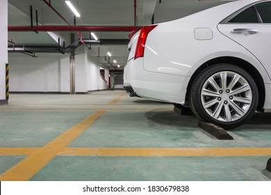 A car parked in the underground parking lot