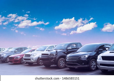 Car parking in asphalt parking lot with white cloud and blue sky background. Outdoor parking lot with fresh ozone and green environment of transportation concept