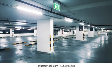 Car parking bar in the area in department store. Indoor parking in shopping center empty space and has enough light so it is safe
