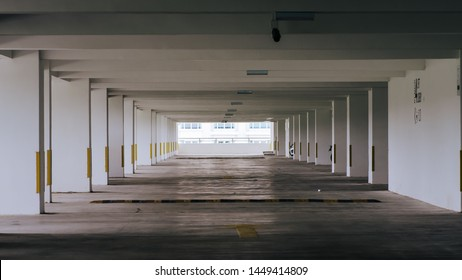 Car parking bar in the area in department store. Indoor parking in shopping center empty space and has enough light so it is safe.