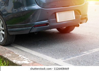 Car parking on roadside with blank license plate background, Bottom of car and road concept