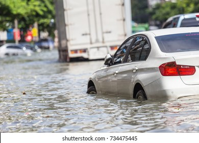 Car parking on the street and show level of water flooding in Bangkok, Thailand