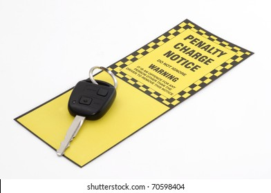 A car parking penalty notice ticket and car key