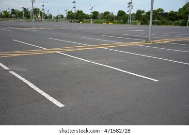 car parking spot on the street with a white line.