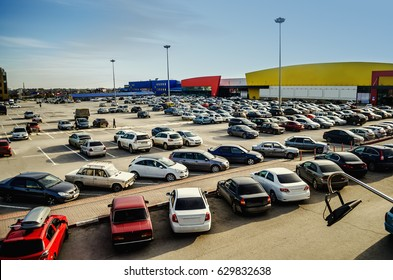 Car parking in the supermarket complex in the evening