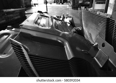 Car parts Produced by Accurate Sheet Metal Stamping Tool Die. Black-and-white photo.