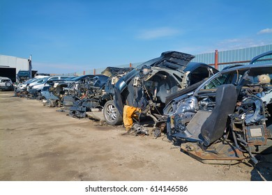 car parts and scrap in a junkyard