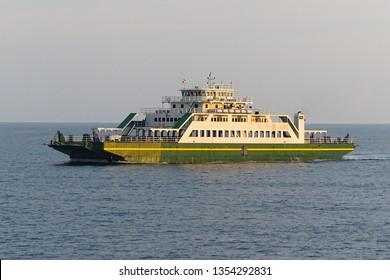 Car passenger ferry ship sailing out of port Labuan island,Malaysia.