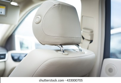 Car passenger leather seat. Interior detail. View from behind