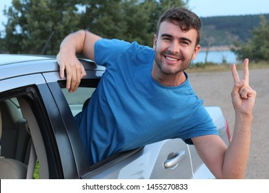 Car passenger showing peace sign during road trip