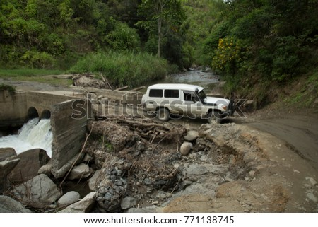 Car is passing destroyed Bridge in the Jungle