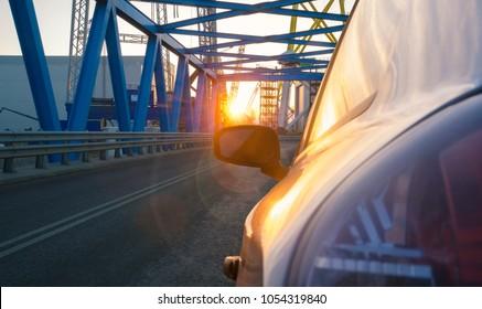 car passing through industrial areas