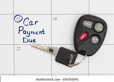 Car Payment Due text with Car key and remote opener on a calendar