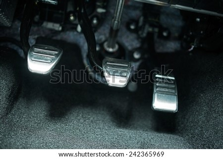 Car Pedals. Modern Car Clutch, Gas and Brake Pedals Closeup.