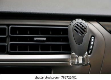 car perfume in front of automobile air conditioning ventilation covers