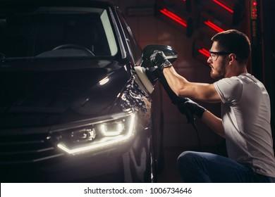 Car polish wax. worker hands holding a polisher and polish car