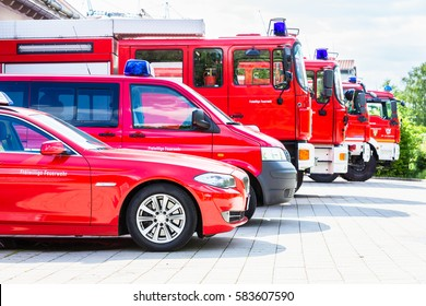 Car pool with fire engines of fire department