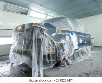 car prepared for painting in a spray booth.