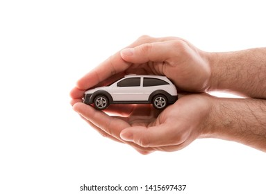 Car protection. Small white car covered by hands isolated on white background with clipping path