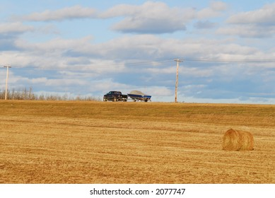car pulling boat on country side