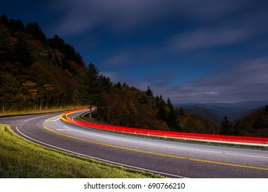Car Races Through Great Smoky Mountains National Park at Night