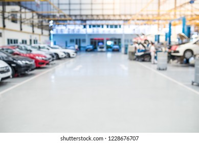 Car raised on car lift in auto service, blurred background for industry