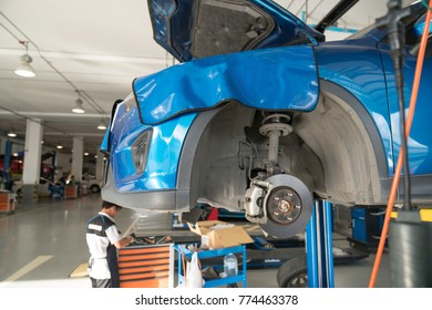 Car raised on car lift in autoservice.