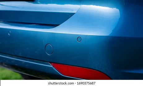 Car rear bumper with parking sensors and fog lights